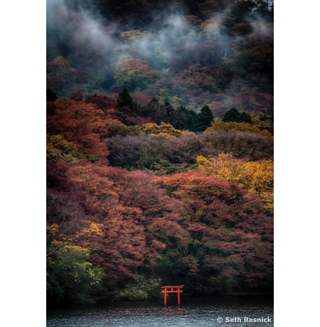 "Hakone Jinja, a Shinto shrine with a red ""torii"" gate from Lake Ashi."